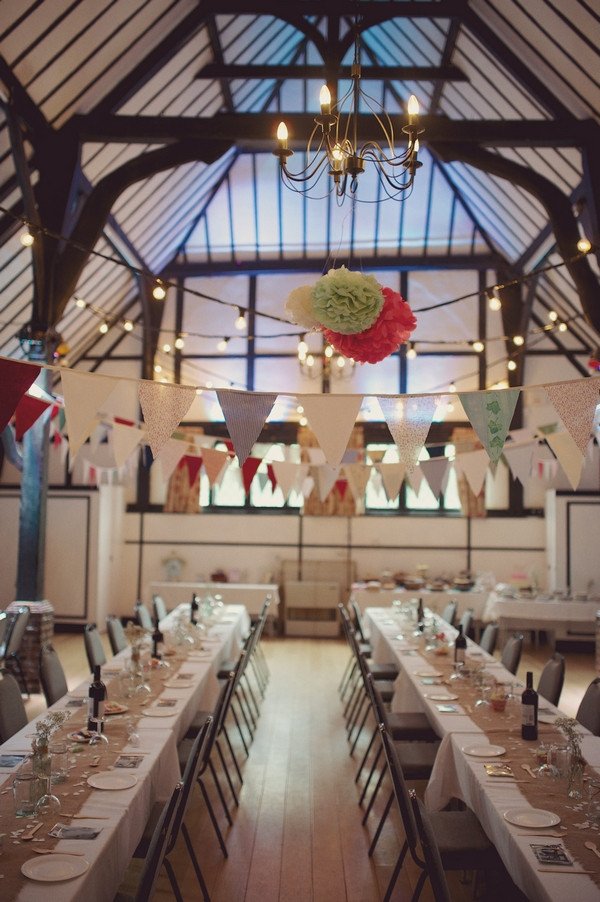 Bunting and wedding tables in Chilham Village Hall in Kent