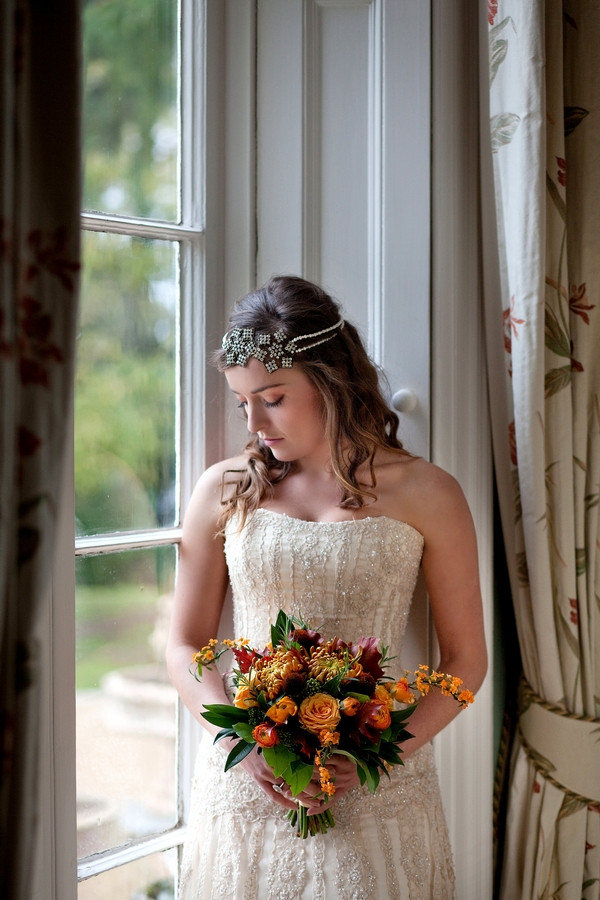 Bride holding autumnal wedding bouquet