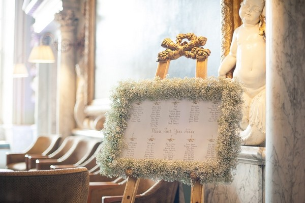 Wedding table plan with gypsophila frame