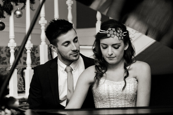 Bride and groom sitting at piano