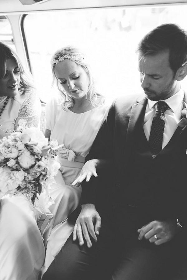 Bride and groom looking at bride's wedding ring