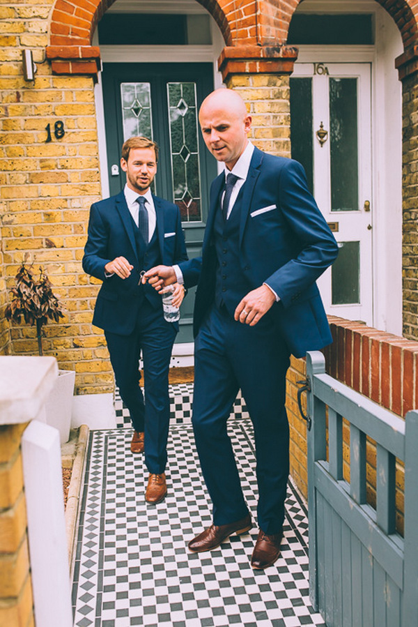 Groom and best man leaving house to go to wedding