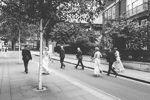Bridal party walking down road