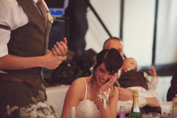 Bride listening to groom speech