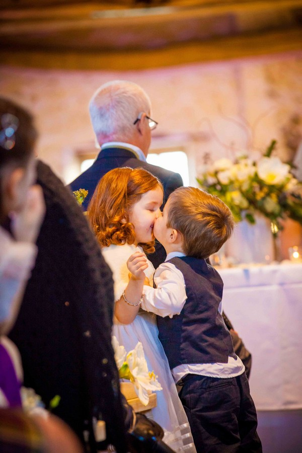 Pageboy kissing flower girl - Picture by Amanda Karen Photography
