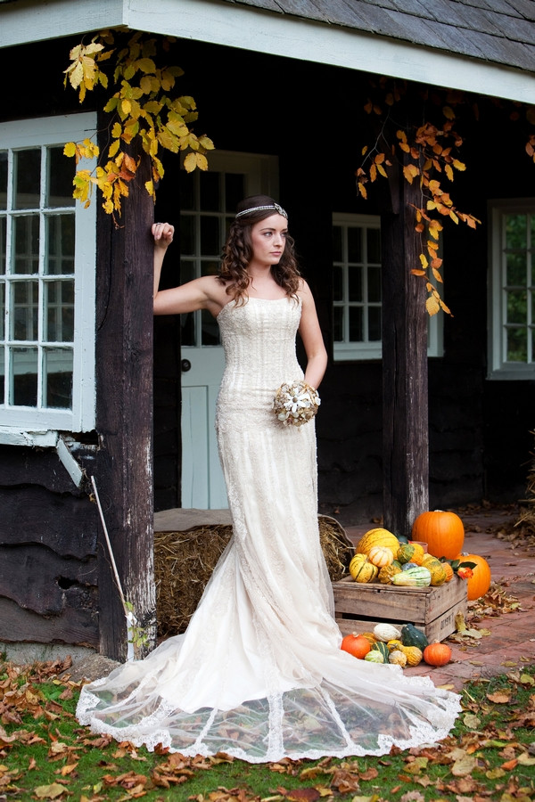 Bride in secret garden of Deer Park in autumn