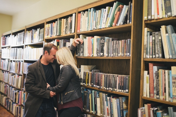 Couple next to book shelves in Middlesbrough Reference Library