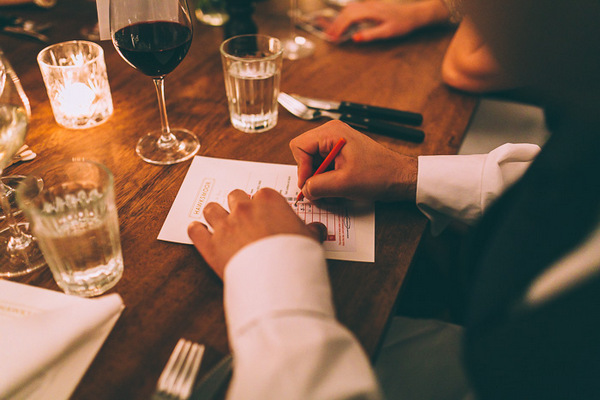 Wedding guest filling out betting slip