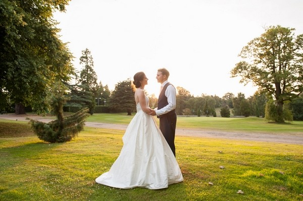 Bride and groom in grounds of Moor Park Mansion