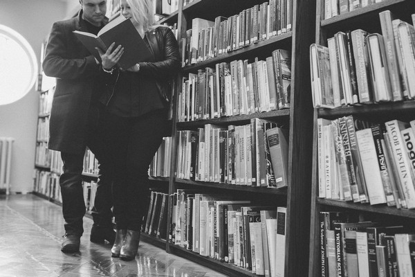 Couple reading book in Middlesbrough Reference Library