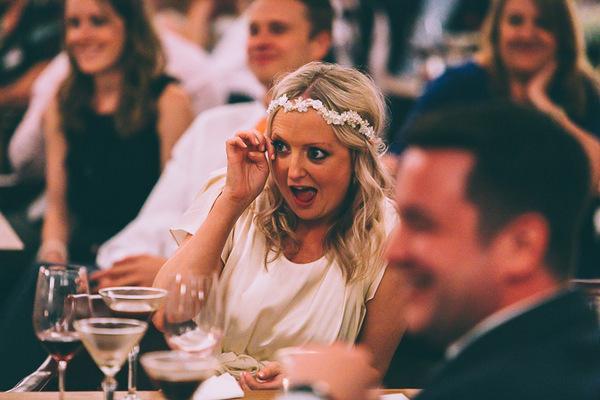 Bride wiping tear from eye