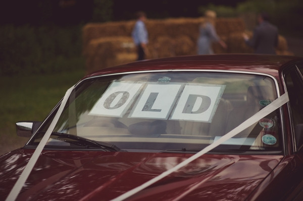Old sign in vintage wedding car