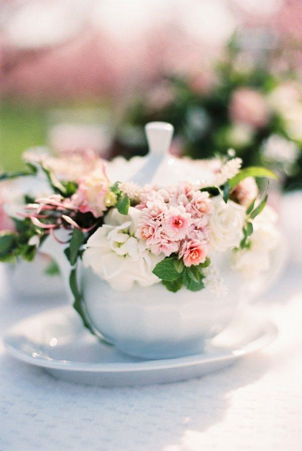 teapot full of pink flowers