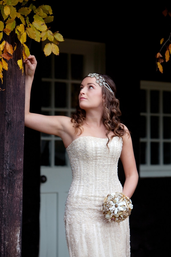 Bride looking up autumnal leaves
