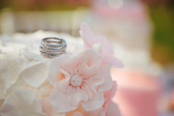 Wedding rings on top of wedding cake