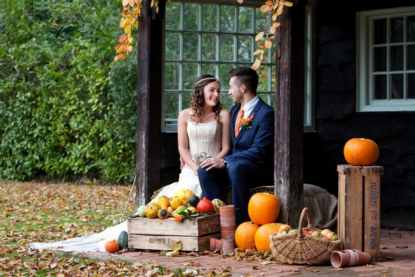 Bride and groom sitting in Deer Park secret garden in autumn