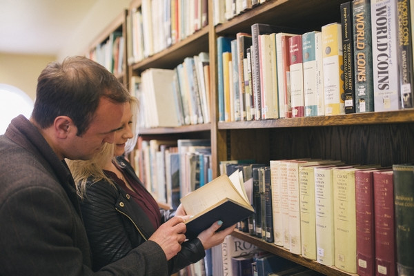 Couple looking at book in Middlesbrough Reference Library