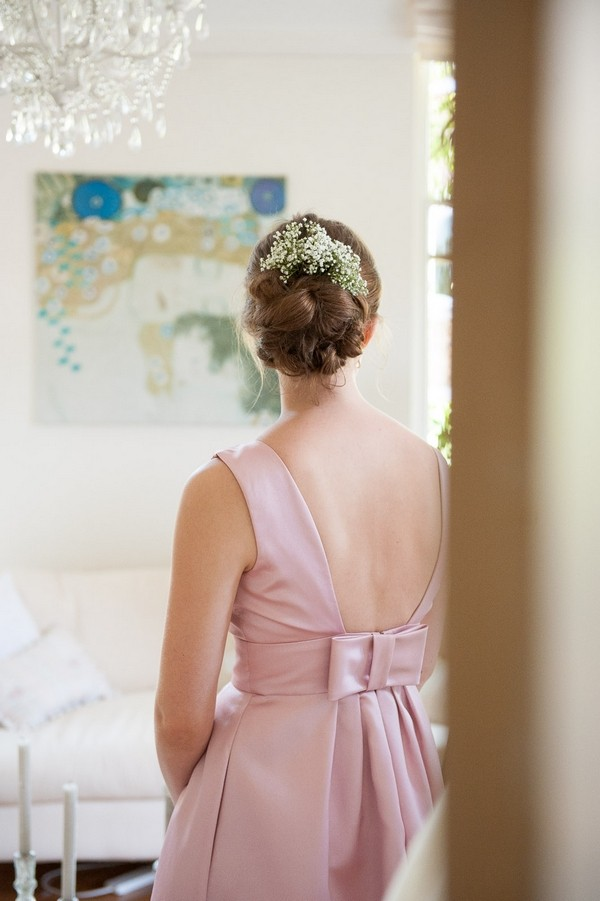 Bridesmaid with pink dress and hair accessory