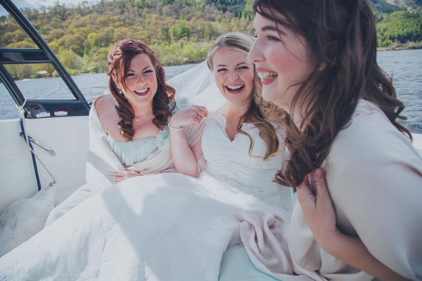 Bride and bridesmaids on speed boat