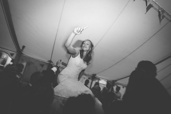 Bride being lifted on dance floor