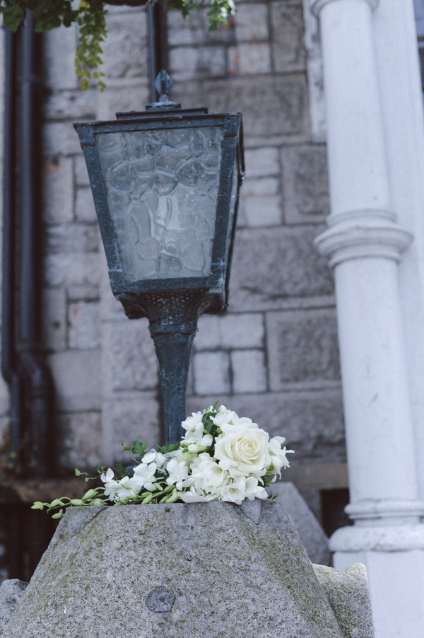 Wedding bouquet by lamp