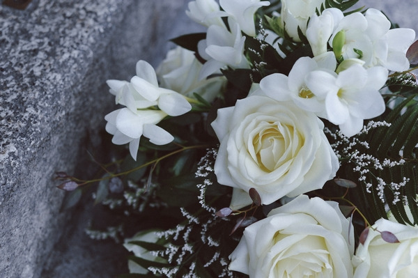 White roses in wedding bouquet
