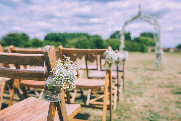 Gypsophila in jars hanging on wedding seat