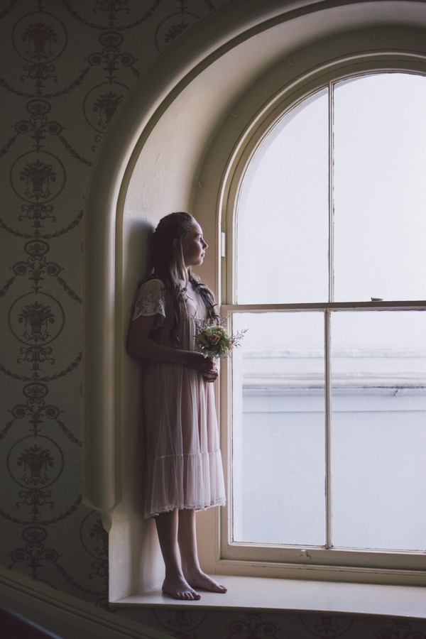 Flower girl standing in window