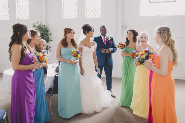 Bride with bridesmaids in brightly coloured dresses
