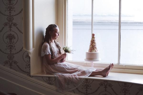 Flower girl sitting on window ledge