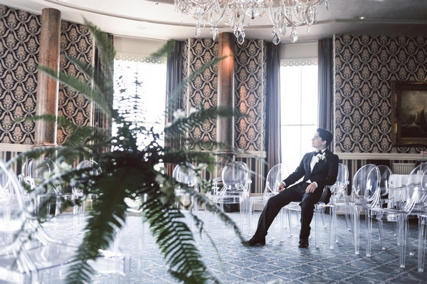 Retro groom waiting for bride in Duke of Cornwall Hotel
