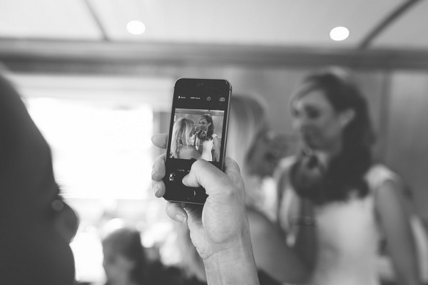 Taking picture of bride on phone
