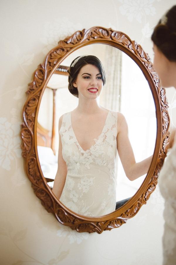 Retro bride looking in mirror