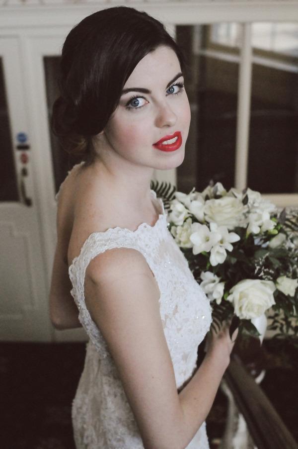 Retro bride holding bouquet