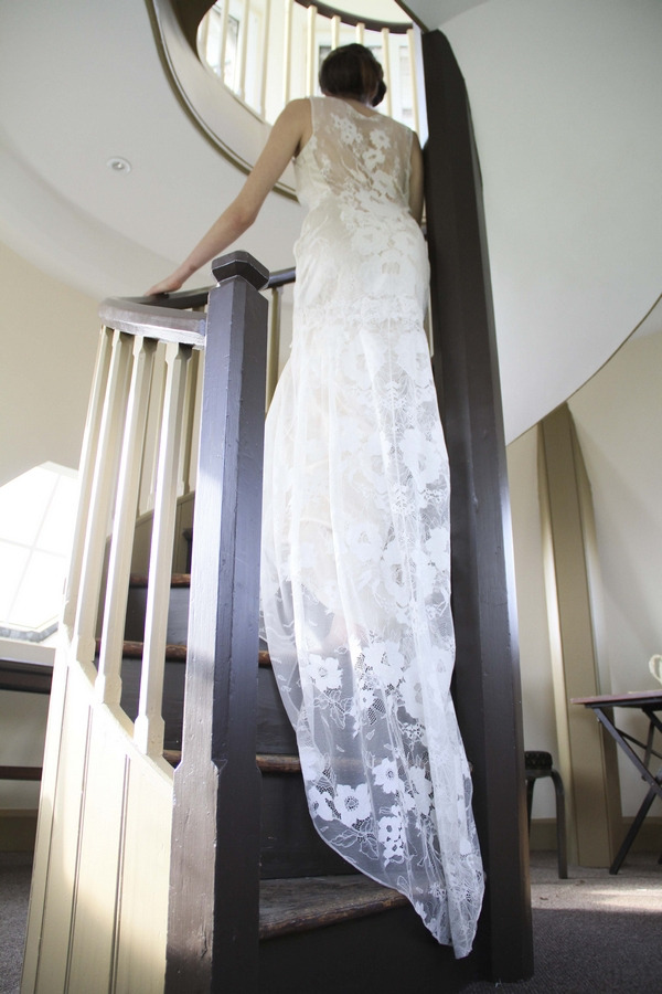 Bride in lace dress going up stairs
