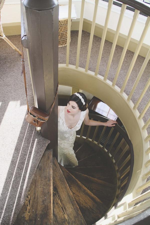 Bride walking up spiral staircase