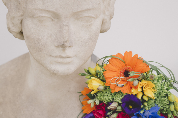 Brightly coloured wedding bouquet on statue