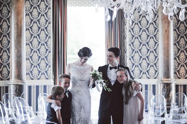 Retro bride, groom, flower girl and pageboys