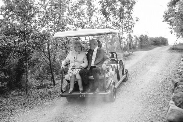Wedding guests on golf buggy