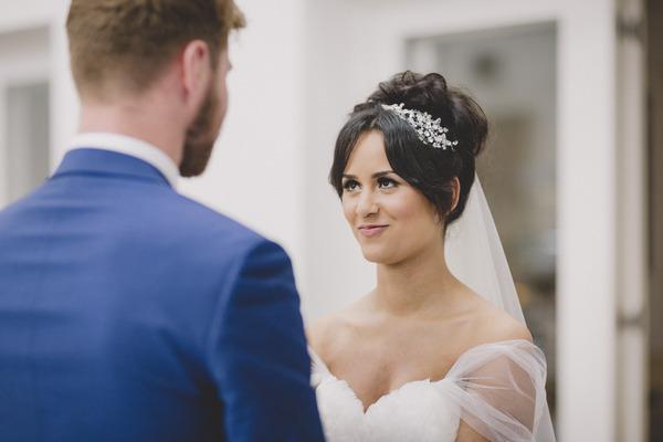 Bride looking into groom's eyes