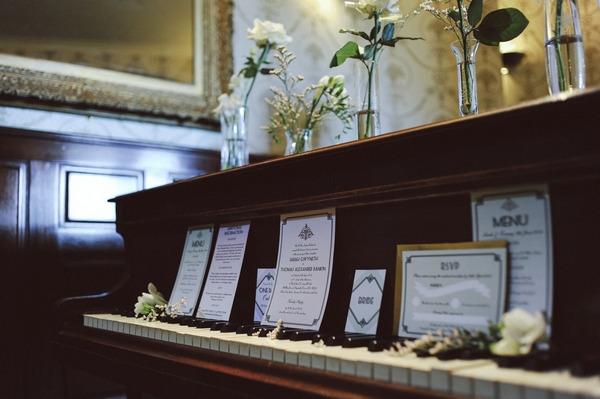 Retro wedding stationery on piano