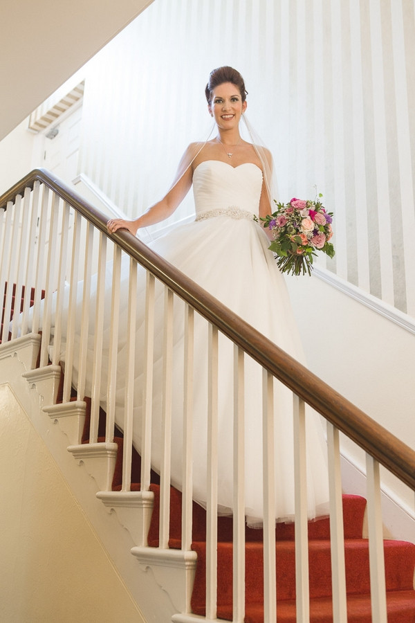 Bride walking down stairs of Horton Grange