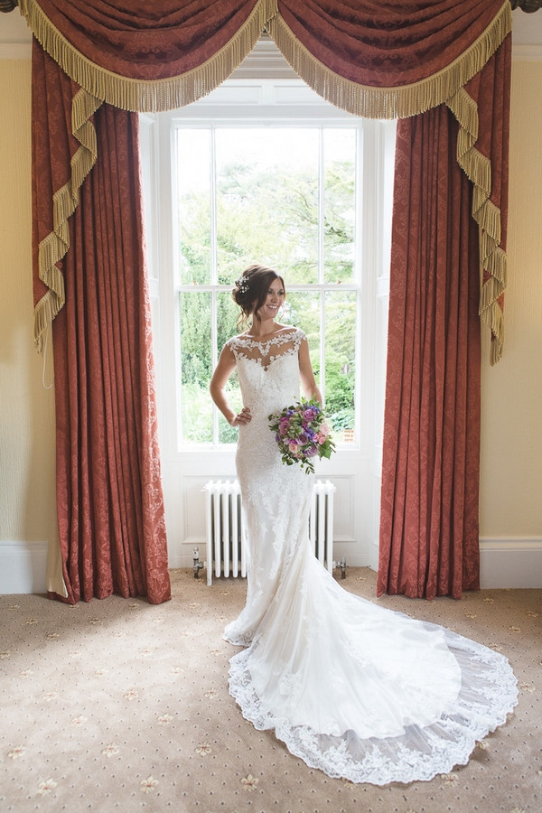 Bride holding bouquet in Horton Grange