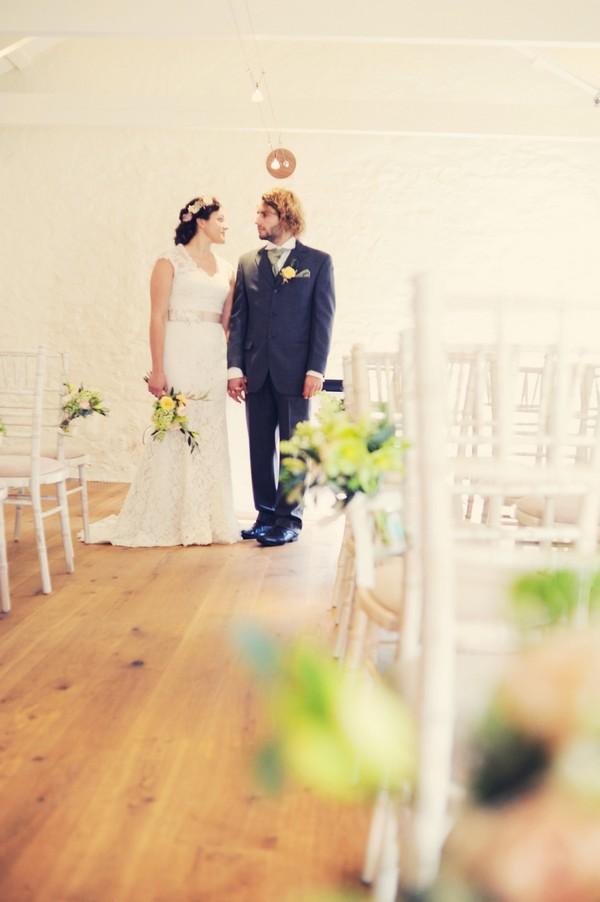 Bride and groom in ceremony room at Cosawes Barton