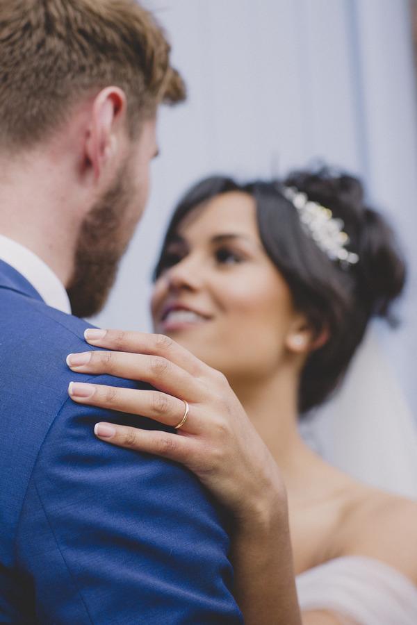 Bride's hand on groom's shoulder
