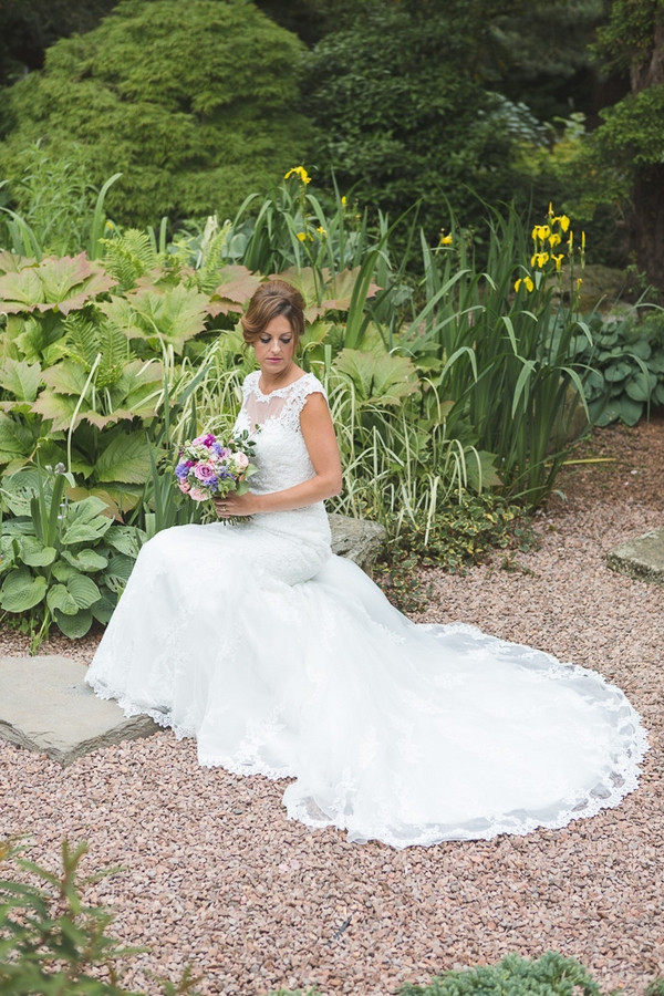 Bride sitting in garden of Horton Grange