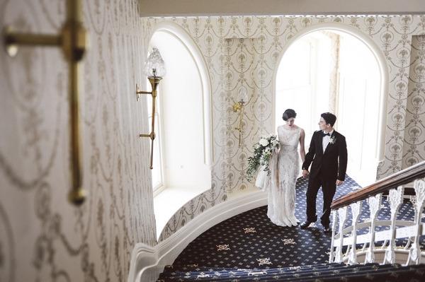 Bride and groom walking up stairs in Duke of Cornwall Hotel