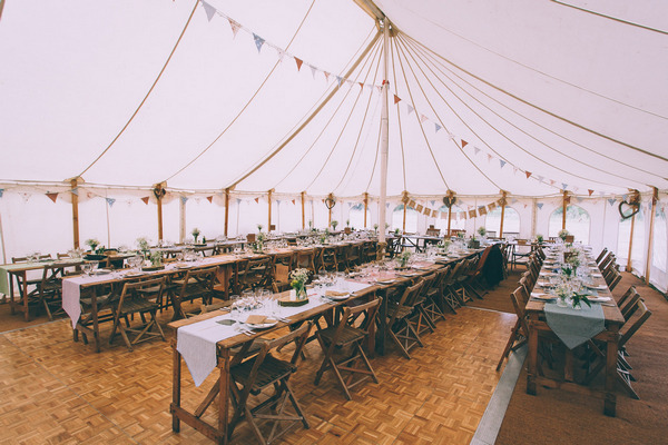 Long wedding tables in marquee
