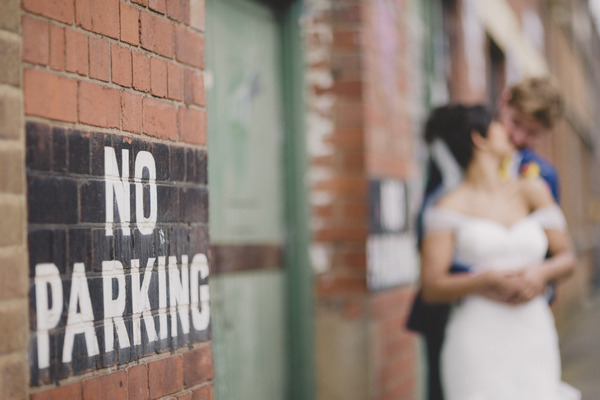 No parking notice with bride and groom in background