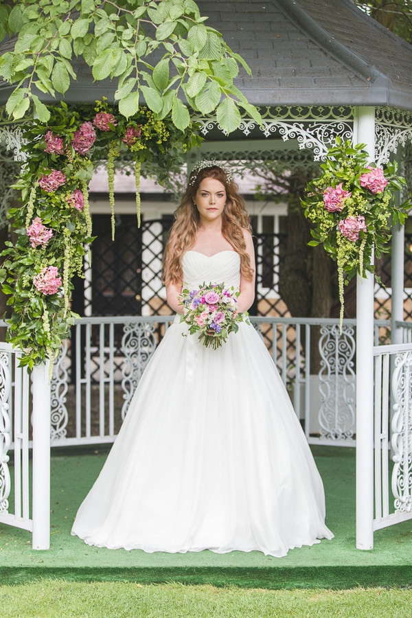 Bride holding bouquet in garden of Horton Grange